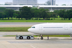 Parking plane. Plane in asian airport Royalty Free Stock Photography