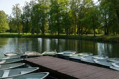 Parking of recreation boats at the Pavlovsk Park territory in Pavlovsk, St Petersburg, Russia. PAVLOVSK, RUSSIA - SEPTEMBER 21, 2017. Parking of recreation boats Royalty Free Stock Image