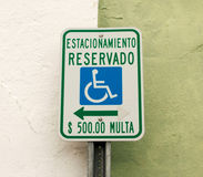 Parking reserved for handicapped only in spanish. A sign written in spanish that says parking for handicapped only or $500.00 fine Royalty Free Stock Images