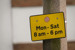 Parking restriction sign. No waiting sign on British street Royalty Free Stock Photos