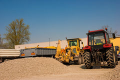 Parking for road maintenance equipment, tractors, graders, trail Stock Photos