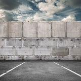 Parking road marking with concrete wall stock images