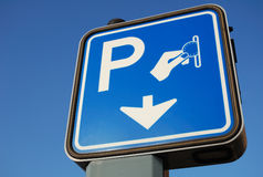 Parking sign. Parking road sign isolated on blue stock photo