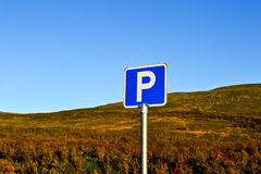 Parking sign. That stands in the wilderness with a great view Stock Photos