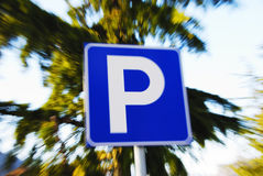 Parking sign. Against nature background with zooming effect Stock Photography