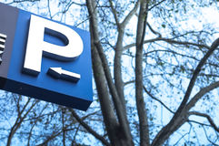 Parking Sign. The parking sign with an arrow indicating direction to go,on a winter background Royalty Free Stock Images