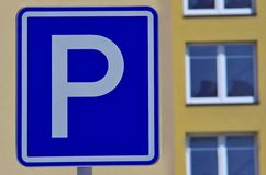 Parking sign. Blue parking sign and prefabricated house in the background Stock Photo