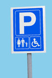 Parking sign for families and disabled. Blue sign with white symbols - parking for families and less able people Royalty Free Stock Photo