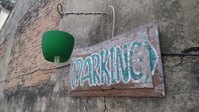 Parking sign on old wall Royalty Free Stock Photos