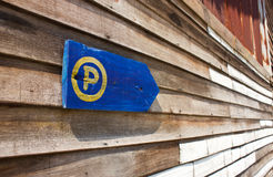 Parking sign  the old wooden wall. Royalty Free Stock Photo