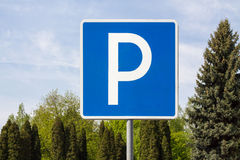 Parking Sign in the Park. At the Trees and Sky Background Stock Images