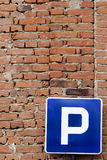 Parking Sign Red Bricks. Parking sign on a red brick wall Royalty Free Stock Images
