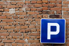 Parking Sign Red Bricks. Parking sign on a red brick wall Stock Photo