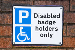 Parking sign. Reserved parking sign for disabled people only on outside wall Stock Photo