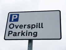 Parking sign UK. Overspill parking sign isolated against sky, UK Royalty Free Stock Image