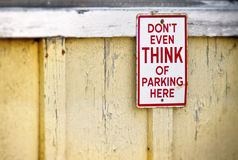 Parking sign on yellow wall Royalty Free Stock Photo