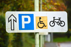 Parking Signs. Parking, Disabled, Bicycle and arrow road signs Royalty Free Stock Photos