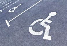 Row of parking sign for disabled people. Row of disabled parking sign indicating parking spaces for disabled or handicapped people on asphalt Stock Photo
