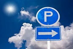 Parking sing with cloudy sky. Parking sing white cloudy blue sky and sun Royalty Free Stock Image