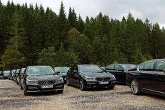 Parking site with luxury BMW cars. Preparations for the G7 summit in Bavaria at Schloss Elmau (Germany) in year 2015 with parked Siebener BMW's, ready for Royalty Free Stock Image
