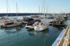 Parking small boats are in the berth of the seaport of Adler royalty free stock photo