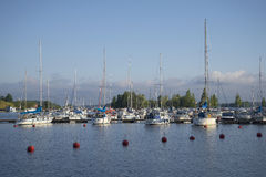 Parking of small size vessels in the Harbor of lake Saimaa on a summer morning. Lappeenranta Royalty Free Stock Images
