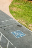 Parking space reserved handicapped on road Royalty Free Stock Image