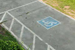Parking space reserved handicapped on road Royalty Free Stock Images
