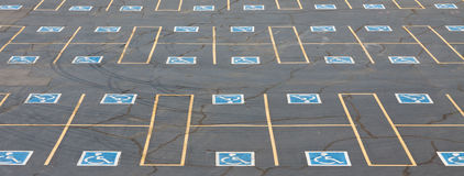 Handicap Parking Spaces. Parking spaces reserved for the disabled in outdoor parking lot Stock Photo