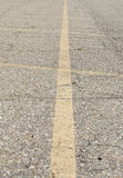 Parking Spaces. Yellow lines marking off parking spaces in an asphalt lot Royalty Free Stock Images