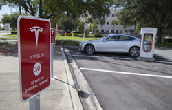 Parking spot at Tesla charging lot Stock Photos