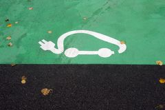 Parking symbol for electric cars being charged.  stock image