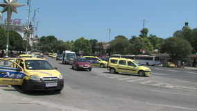 Parking a taxi in the center of Varna, Bulgaria stock footage