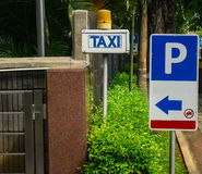 Parking and taxi sign board at gate of Central Park Mall photo taken in Jakarta Indonesia stock photos