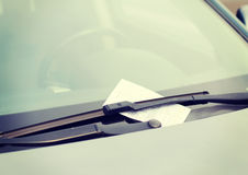 Parking ticket on car windscreen Stock Images