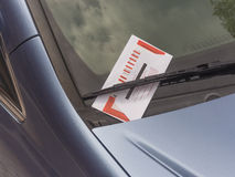Parking ticket. On motor car windscreen or windshield Royalty Free Stock Photo