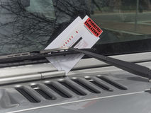 Parking ticket. On motor car windscreen or windshield Stock Images