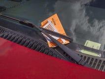 Parking ticket. On motor car windscreen or windshield Stock Photo
