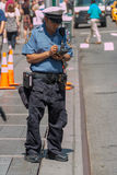 Parking Ticket. New York - Aug 20: NYPD Traffic officer writes a parking ticket for a parking violation on August 20, 2014 in New York, USA Stock Photography
