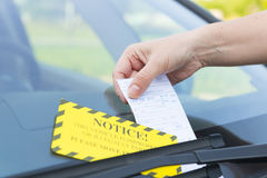 Parking ticket. Placed under windshield wiper Stock Photography