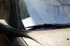 Parking Ticket in Wind shield wiper Stock Photo