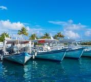 Parking traditional Dhoni boats, Maldives. Parking traditional Dhoni boats near the pier of the tropical island, Maldives Stock Images