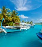 Parking traditional Dhoni boats, Maldives. Parking traditional Dhoni boats near the pier of the tropical island, Maldives Royalty Free Stock Image