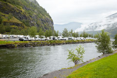 Parking under the mountain on the shore. Of the water channel Royalty Free Stock Photos