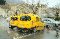 Parking under rain. Abstract view (through the car windscreen) of the parking under rain royalty free stock images