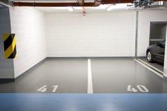 Parking in underground garage. Car parking in an underground garage Royalty Free Stock Photography