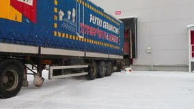 Parking unloading cargo from truck to warehouse. 28 November 2015 Novosibirsk stock video