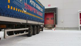 Parking unloading cargo from truck to warehouse stock video footage