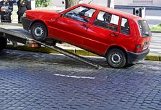 Parking violation 2. Red car towed because of parking violation Royalty Free Stock Image