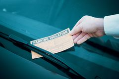 Parking violation ticket fine on windshield Stock Images